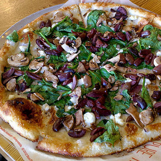 An appetizing picture of a build your own pizza at Blaze